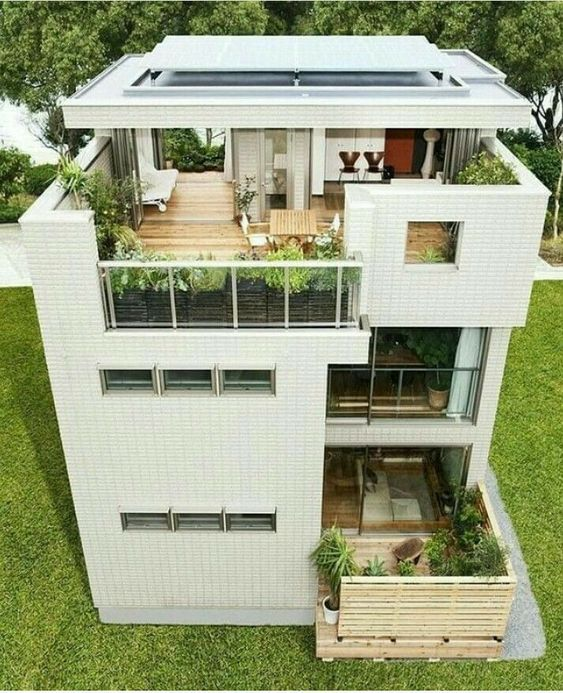 Fachada de casa con 2 terrazas