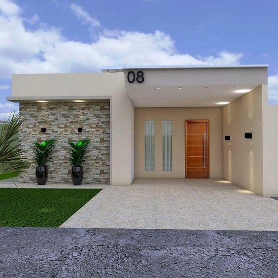 Fachada de casa pequeña moderna con piedra de cantera y jardín