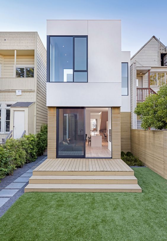 Fachada minimalista de casa pequeña de dos pisos