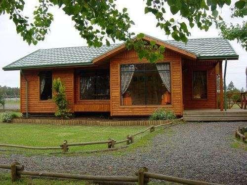 Casa de madera y teja estilo rústica