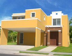 Casa grande de dos pisos sencilla en color mostaza