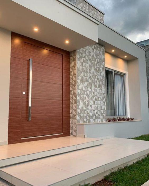 Fachada de casa moderna con piedra artificial