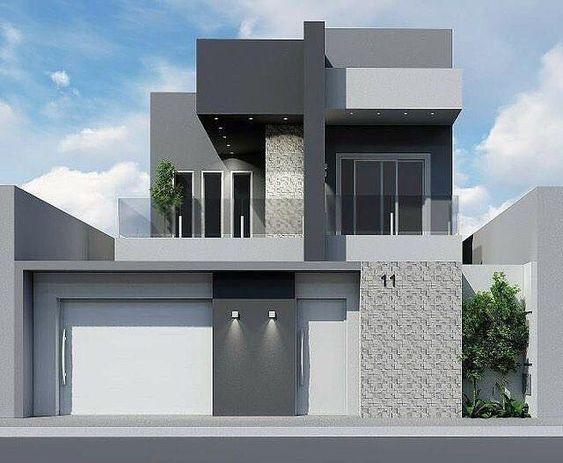 Fachada de casa moderna de dos pisos con tonos neutrales